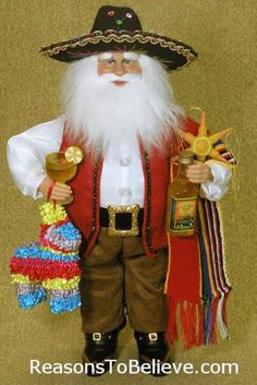 16 inch Fiesta Santa - Hispanic--This year, Santa is going south of the border for some holiday celebration. With his margarita poured and all ready to enjoy, Santa brings his traditional Mexican burro pinata for some extra holiday party excitement. With a full bottle of tequila, Santa is sure to make this trip a memorable one!