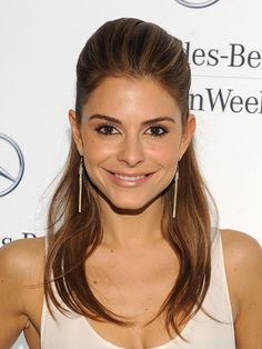 Give yourself a raiseliterally. If backcombing isn't enough to give you Maria Menounos' enviable bump, here's a way to cheat it: Pull the top half of your hair straight up over your headas if you were creating a super-high half-ponyand secure the elastic halfway between your roots and your tips, so it's very loose. Then stuff the ends of your strands, along with the elastic, underneath the hair at the crown. Secure with a few bobby pins to create a modern-looking bouffant…