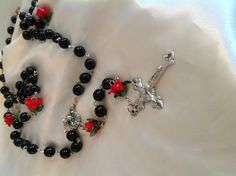 Obsidian and rose lampwork bead rosary (cast medals/sterling silver chain)