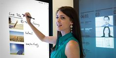 Surface Hub an all-in-one digital interactive whiteboard fosters team collaboration. Surface Hub, Touch Screen Technology, Interactive Whiteboard, Teamwork, Fitbit, Workshop, Relax, Spaces, Woman