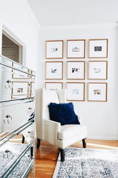 square framed prints in the corner near a chair (downstairs by mirror)