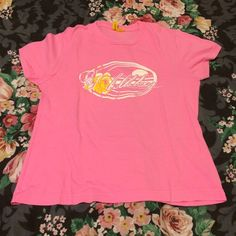 NEW LISTING  Pink Billabong Shirt Gently preloved as shown on the last picture (minimal wear on the front design of shirt) but still has a lot of life left  100% cotton. Turn garment inside out before wash, machine wash cold, tumble dry low, no bleach. ⛔️ NO TRADES, NO PAYPAL, NO MERCARI, NO HOLDS ⛔️ smoke free, pet free home  let me know if you have other questions  PLEASE MAKE OFFERS THROUGH THE OFFER BUTTON. Billabong Tops