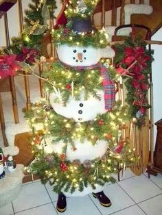 Snowman made out of a lighted christmas tree