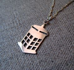 TARDIS necklace in silver by PicaPicaPress on Etsy, I just geek   out! I want one fro my B-Day!
