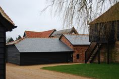 M&M Roofing Supplies Ltd - Clay Roof Tiles UK. We are specialist suppliers of natural roofing products with emphasis on clay roof tiles and natural roofing slates. Clay Roof Tiles, Tiles Uk, Roofing Supplies, Slate Roof, This Is Us, Things To Come, Cabin, House Styles, Natural