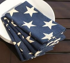 """Star spangled with patriotic pride, our linen/cotton napkins are the perfect accent for your Fourth of July feast, or any other lively summer gathering. 20"""" square Made of printed linen/cotton. Set of 4."""