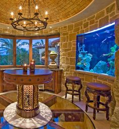 Backyard Pond  This indoor-outdoor space shows that even in the most luxurious areas, aquariums can still stand out.