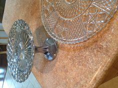 Pedestal plate for jewelry in bathroom. Made using glass plate, candle stick, e6000, and krylon looking glass spray!