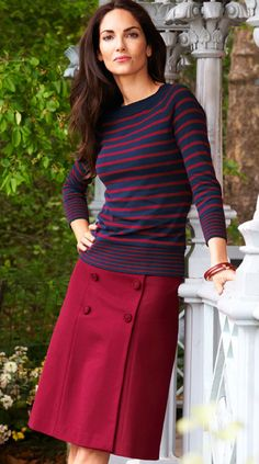 Accessory Count:  Five accessory points at work is best. Vivid colors, patterns, belts, shoes, jewelry, handbags and buttons all count. For this look: Buttons - one point. Stripes - one point. Big bangle - three points because it's big and eye-catching. Too much in fact. Vivid raspberry color - one point.  Ditch that bracelet and this is a successful workplace look. Her dress code is right for a traditional-casual office and her style says she's energetic and get-it-done.