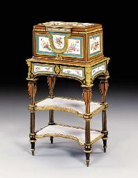 A LOUIS XVI ORMOLU AND SÈVRES PORCELAIN-MOUNTED AMARANTH, SYCAMORE AND BOIS SATINÉ JEWEL COFFER ATTRIBUTED TO MARTIN CARLIN, STAMPED SCHNEIDER, CIRCA 1778, THE LOWER TWO TIERS AND COLUMNAR LEGS EXECUTED BY SCHNEIDER TO COMPLETE AN EXISTING CARLIN JEWEL COFFER, BLUE INTERLACED L'S ENCLOSING DATE LETTERS AA FOR 1778 TO THREE PLAQUES, ONE WITH THE PAINTER'S MARK LG FOR LE GUAY L'AÎNÉ, THE OTHER PLAQUES ATTRIBUTED TO EDMÉ-FRANÇOIS BOUILLAT Price realised USD 1,546,000