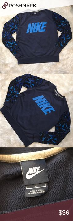 Nike Men's Blue Sweater Pullover Sz L Nike men's blue sweater crew neck Pullover., the sleeves are a blue camp otters mixed with black and a lighter blue. This is a men's Large but can also fit a woman if she wants to put with some cute cutoff shorts and sneakers! Never worn! Brand new. Offers are welcome! Price isn't firm!!! Approximate measurements are shown in photos! Nike Sweaters Crewneck