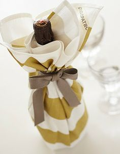 Wine wrapped with tea towel and ribbon. Cute hostess gift