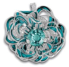 A camellia brooch with a single  38-carat, blue-green Paraiba tourmaline, which is encircled by diamonds and sea-blue enamel