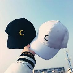 Super trendy adjustable cap with an embroidered gold or black moon. This is the Sailor Moon cap with the iconic half-moon emblem on the face of the hat. The hat is available in white with a black moon