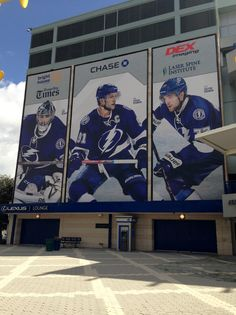 Show off your biggest players by displaying them larger than life on your building through a wallscape. Nhl Logos, Tampa Bay Lightning, Larger, Building, Sports, Life, Construction, Storage, Buildings
