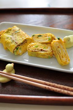 Japanese rolled egg, Tamago-yaki.. Simplest recipe, with just the usage of eggs, small amount of sugar and salt, and your creativity of the other ingredients added such as carrot, green onion, cheese, ham or whatsoever..
