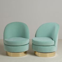 A Standard Pair of Swivel Chairs by Talisman Bespoke