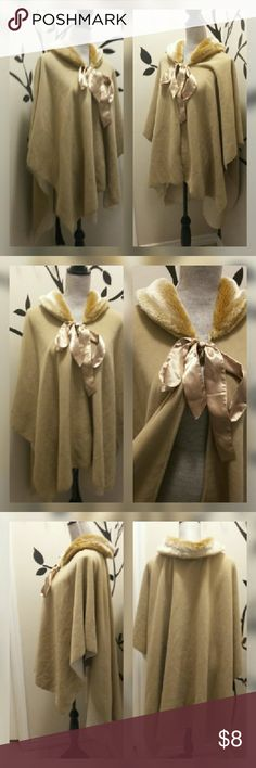 Beautiful poncho Tan and cream. Hook and eye on front with ribbon tie. Fluffy around neck. High-low affect. 100% polyester. Jackets & Coats Capes