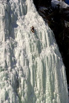 Ice climbing on frozen Montmorency Waterfall in Quebec, Canada.