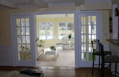 Doors closing off the sunroom from livingroom