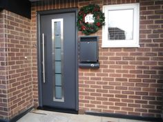Hormann Thermo Pro Plus entrance door in titan metallic decograin.