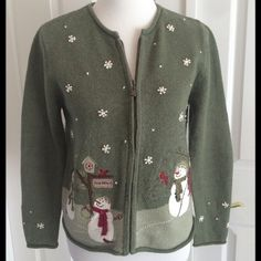 "Christmas  Sweater Green zip front cardigan Christmas sweater with snowmen appliqués on the front and back and embroidered snowflakes. Good condition with a little pilling under the arms. No other sign of wear. Fabric: 55% ramie, 15% acrylic, 9% wool, 6% angora. Length 21.5"". Bust 19"". Sleeve length 23"". Smoke free home. Fast shipper. Croft & Barrow Sweaters"