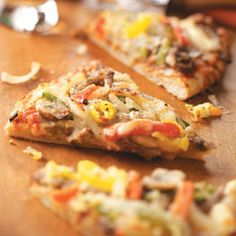 Traditional Philly Cheesesteak Pizza Recipe -Sometimes my family likes their pizza crust extra crispy, so I prebake the crust for 5 minutes before adding the toppings. There are never leftovers. —Laura McDowell, Lake Villa, Illinois