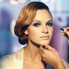 Smokey eye with blue hues.    Tip: when opting for a bold look for the eyes, use softer, muted colors for the lip.  So the too areas don't compete.