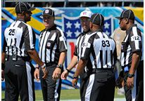 Image: NFL referees meet before a game between the San Diego Chargers & Atlanta Falcons on Sunday (© Denis Poroy/AP)