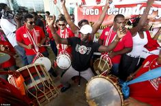 Olympic fever: Trinidad and Tobago's Olympic hero Keshorn Walcott was greeted by a carnival atmosphere at Piarco International Airport.  Olympics 2012