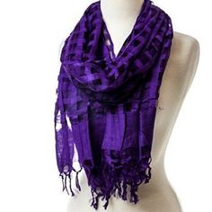 This rich Purple Windowpane Scarf adds a vibrant pop of color in a lightweight and fashionable material. The dimension from the windowpane design is fun for any style.