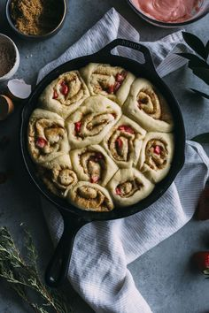 Strawberry rhubarb cinnamon rolls that are filled with fresh strawberries and rhubarb and topped with a fruity glaze!