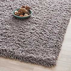 This hand-woven acrylic shags offer luxurious comfort in a trendy lifestyle  rug. High-density acrylic pile features a grey background