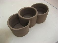 wheel thrown pottery ideas | Alan Dowdy cut and assembled his three compartments into one pot.