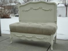 Stunning settee/bench made from a twin bed! Wood was refinished in soft white and has swag appliques on the headboard and footboard. The s...
