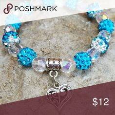 Blue Heart Bracelet Blue Shamballa Beads with alternating Crystal beads. Finished off with an adorable silver heart charm to make it oh so sweet. Accessories