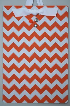 $1 flat cookie sheet from Dollar Tree + spray adhesive  fabric = magnetic board for inside cabinet doors