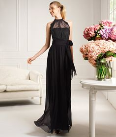 Pronovias presents the Caricia cocktail dress from the 2013 Long collection. Black bridesmaids dress
