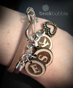 Laser cut and engraved wood letter charms. http://www.brickbubble.ca
