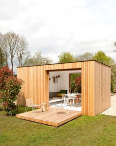 on our list of 100 Big Ideas Firm: Filip Janssens. Idea: Tom Lierman Office of Architecture and Interiors designed Filip Janssens a barnlike residence, and Janssens added a small garden pavilion with an exterior clad in larch plan Backyard Office, Backyard Studio, Garden Studio, Garden Office, Home Office Design, House Design, Garden Cabins, Garden Pavilion, Casas Containers