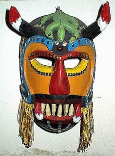 Diablo mask  Colima    11 inches, wood, paint, cloth fringe, glitter    Devil masks usually depicted men with horns. A typical performance would be one in which Lucifer and his band of devils try to conquer the earth, only to be driven back underground by the power of Christianity. Beating a devil in a ritual battle would be symbolic of defeating death, and of bringing an end to hardship. Even today, devil mask-making contests continue this artistic tradition in Mexico.