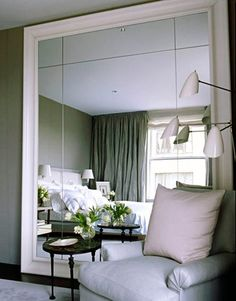 """massive, over-scale mirror against wall.  """"an architectural approach to a decorative object — like cutting open a wall onto a space beyond"""" - Vicente Wolf"""