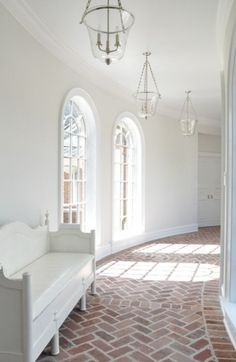 love the white washed pavers. kathleen clements' curved hallway with arched windows, brick floor laid in a herringbone pattern, lanterns and white walls Home Interior, Interior And Exterior, Interior Design, Brick Interior, Exterior Paint, Interior Ideas, Modern Interior, Interior Architecture, Design Living Room
