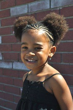 Adorable!  Braid Puffs.  I like the cornrow pattern.