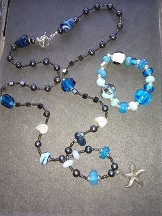 Some seaside style beads in a set of necklace and bracelet