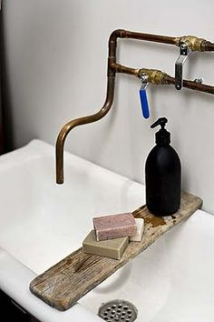 Plank across a sink where there is nowhere to put soap. Use of basic plumbing materials to make a mixer tap.