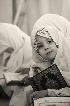 Cute Girl Holding Al-Quran Didik anak hafal Al-Quran http://naniestorie.blogspot.com/2013/06/didik-anak-hafal-al-quran.html