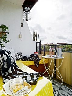 black white and yellow balcony decor