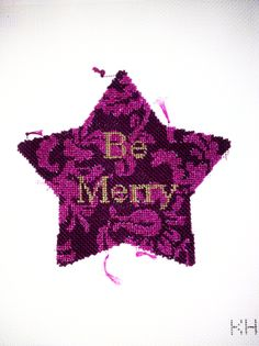 Be Merry Star.  Stitched by Lizzy Hardy. needlepoint canvas by Kirk and Bradley