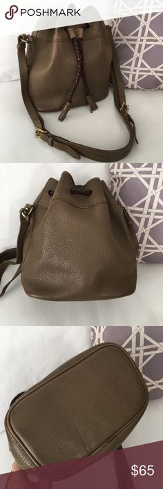 Vtg Dooney Bourke Teton Drawstring Bucket Bag Authentic Vtg AWL (All Weather Leather) Dooney & Bourke Teton drawstring bag in tone/tone brown (mushroom?? It's darker than taupe color but not quite as dark as the mushroom coin purses, also for sale). Overall in fair-good condition. Heavy signs of use, patina, nicks, wear and scratches, most notable at the bottom/corners, strap, discoloration where the Drawstring folds in front. A red mark on the back. Inside has pen marks & spots…